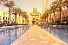 DUBAI, UAE - July 11, 2017: A view of Souk al Bahar and the turquoise Burj Khalifa in a Lake surround by greenery Stock Photography