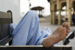 Dubai UAE man taking rest on park bench along boardwalk in Bur Dubai Stock Image