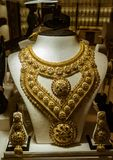 Massive gold jewelry for sale at a Gold Souk Stock Images