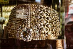 Massive gold ring for sale at a Gold Souk is the largest in the Stock Images