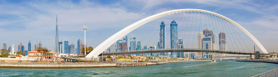 DUBAI, UAE - MARCH 27, 2017: The evening skyline with the arched bridge over the new Canal and Downtown Royalty Free Stock Photography