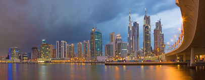 DUBAI, UAE - MARCH 24, 2017: The evening skyline with the bridge over the new Canal and Downtown with ths storm clouds Royalty Free Stock Photo