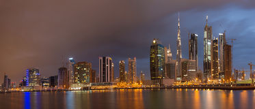 DUBAI, UAE - MARCH 24, 2017: The evening skyline with the bridge over the new Canal and Downtown with ths storm clouds Stock Photography