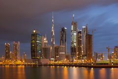 DUBAI, UAE - MARCH 24, 2017: The evening skyline with the bridge over the new Canal and Downtown with ths storm clouds Royalty Free Stock Photos