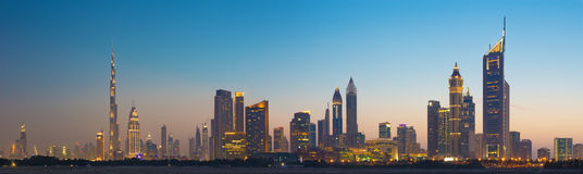 DUBAI, UAE - MARCH 31, 2017: The evening skyline of Downtown with the Burj Khalifa and Emirates Towers Stock Images