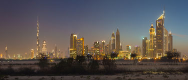 DUBAI, UAE - MARCH 31, 2017: The evening skyline of Downtown with the Burj Khalifa and Emirates Towers Royalty Free Stock Photos