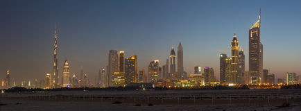 DUBAI, UAE - MARCH 31, 2017: The evening skyline of Downtown with the Burj Khalifa and Emirates Towers Stock Photo