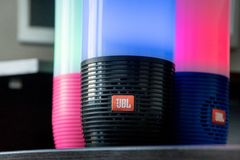 DUBAI, UAE - MARCH 14, 2019: Three JBL bluetooth speakers close up in the hotel room stock photography
