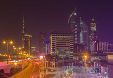 DUBAI, UAE - MARCH 31, 2017: The nightly skyline of Downtown with the Burj Khalifa and Emirates Towers Royalty Free Stock Photography