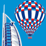 Dubai, UAE - March 22, 2016: vector illustration of Burj Al Arab hotel and air balloon. Burj Al Arab is UAE landmark, and one of the world's most luxurious Royalty Free Stock Photo