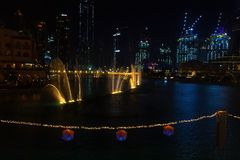 Dancing fountains in focus night background selective focus Dubai UAE. Shallow depth of field. Dubai, UAE - May, 2019: Dancing fountains in focus night royalty free stock photo