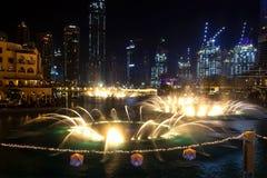 Dubai, UAE - May, 2019: Dancing fountains in focus night background selective focus Dubai UAE. Shallow depth of field.  stock images