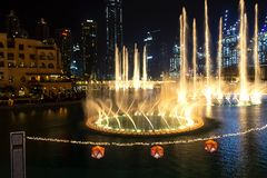 Dubai, UAE - May, 2019: Dancing fountains in focus night background selective focus Dubai UAE. Shallow depth of field.  royalty free stock photography