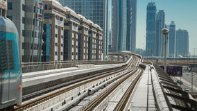 DUBAI, UAE - MAY 2017: The Dubai Metro arriving at a platform, it is the world`s longest driver less, fully automated. 4K Timelapse in Dubai, United Arab stock video footage