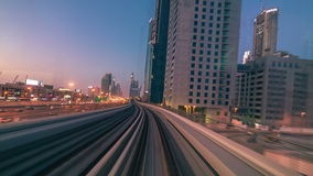 DUBAI, UAE - MAY 2017: Journey on fully automated metro rail network in Dubai, UAE. The view through the front window. 4K Timelapse in Dubai, United Arab stock video footage