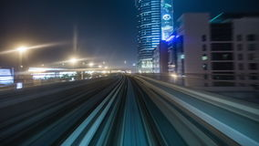 DUBAI, UAE - MAY 2017: Train is approaching and enters into metro station in Dubai is a city and emirate in United Arab. 4K Timelapse in Dubai, United Arab stock video