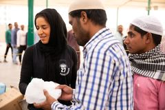 Food packages` distribution in mosque during Ramadan iftar meal.