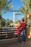 DUBAI, UAE - NOV 12, 2018: Burj al Arab seen from Madinat Jumeirah by young tourist couple in honeymoon. stock images