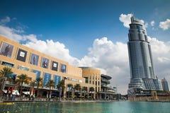 Dubai, UAE. Nov. 22, 2013 - Dubai, UAE: Modern City of Dubai, Business Bay district, Dubai Mall at left with several people walking at the promenade. Dubai is Royalty Free Stock Image