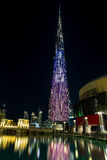 DUBAI, UAE - NOVEMBER 8, 2016: Burj Khalifa skyscraper is tallest in the world. Color projection on a building skyscraper. Stock Photos