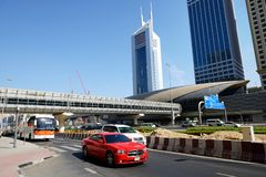 The Dubai cars traffic is near Dubai Metro station and Emirates Towers royalty free stock photography