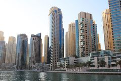 Dubai, UAE. November 23, 2017. Luxury skyscrapers in Dubai Marina Bay. Embankment. Reflections in glass. Reflections in water. Edi. Modern city of eternal summer Stock Image