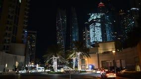 The night illumination of Dubai Marina and Cayan Tower. Dubai, Uae - November 19: The night illumination of Dubai Marina and Cayan Tower on November 19, 2017 in stock footage