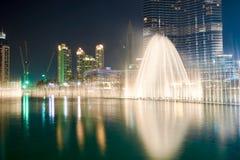 Downtown Dubai. DUBAI, UAE - OCTOBER 15, 2014: The Dubai Fountain at night. The Dubai Fountain is the world's largest choreographed fountain system set on the 30 Stock Images