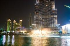 Downtown Dubai. DUBAI, UAE - OCTOBER 15, 2014: The Dubai Fountain at night. The Dubai Fountain is the world's largest choreographed fountain system set on the 30 Stock Photography