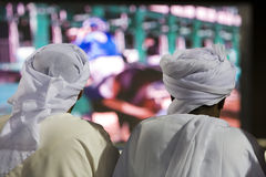 Dubai UAE Two men traditionally dressed in dishdashs and gutras Stock Photos