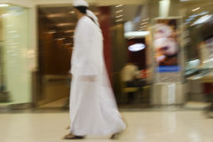 Dubai UAE Two men traditionally dressed in dishdashs and gutras white robes and headdresses. Stock Images