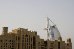 Dubai UAE world famous Burj Al Arab Hotel seen beyond old windtowers Stock Photos