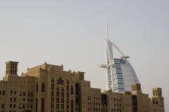 Dubai UAE world famous Burj Al Arab Hotel seen beyond old windtowers Stock Photos