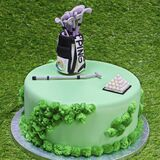 Dubai, United Arab Emirates - August 24, 2020 Designed birthday cake on a green grass background, Golf theme