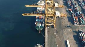 DUBAI, UNITED ARAB EMIRATES - DECEMBER 29, 2019. Aerial view of Jebel Ali port berth and docked cargo ships