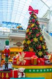 Dubai, United Arab Emirates - December 12, 2018: Decorated Christmas tree with gifts in the mall stock photos