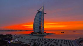 Dubai/United Arab Emirates, 2018, Famous luxury 7 Star Hotel in the World Burj Al Arab Jumeirah, Colorful Night View with Cloudy s. Ky, Best place to visit and royalty free stock image