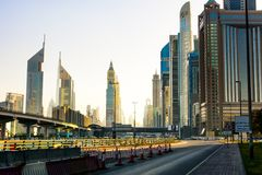 Dubai, United Arab Emirates - February 5, 2018: Dubai downtown street view of the road and Downtown Dubai skyscrapers Stock Photos