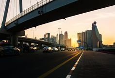 Dubai, United Arab Emirates, February 11, 2018: Dubai street sce. Ne with constantly alive traffic with new city view at sunset stock image