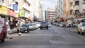 The streets of old Dubai. Car traffic. Cars parked at the curb. Slow motion. DUBAI UNITED ARAB EMIRATES - JANUARY 08 2019: Arab streets: residential houses stock footage