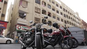Motorcycles parked on the side of the road in the old residential area of Dubai, United Arab Emirates. DUBAI UNITED ARAB EMIRATES - JANUARY 08 2019: Motorcycles stock footage