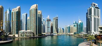 Dubai, United Arab Emirates - March 8, 2018: Dubai marina panoramic day time view with modern skyscrapers and calm water. In Dubai, United Arab Emirates royalty free stock photography