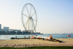 Dubai, United Arab Emirates - March 8, 2018: JBR, Jumeira Beach. Resort beach with Ain Dubai ferris wheel emirates future atraction Royalty Free Stock Photo