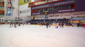 DUBAI, UNITED ARAB EMIRATES - MARCH 31st, 2014: The ice rink of the Dubai Mall, Dubai Mall is the largest shopping mall royalty free stock photo