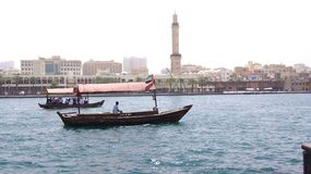 DUBAI, UNITED ARAB EMIRATES - MARCH 31st, 2014: Traditional wooden boats on Dubai Creek as an ferry Stock Photography