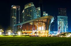 Dubai, United Arab Emirates - May 18, 2018: Dubai opera building. And modern skyscrapers of the Dubai mall surroundings at night stock image