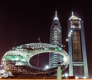 Free Dubai, United Arab Emirates; Modern Museum Of The Future Under Construction, Emirates Towers At Night. Stock Photography - 160895292