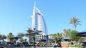DUBAI, UNITED ARAB EMIRATES, UAE - NOVEMBER 20, 2017: Beautiful pool hotel Al Naseem Madinat Jumeirah with view of Burj. DUBAI, UNITED ARAB EMIRATES, UAE stock video
