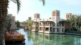 DUBAI, UNITED ARAB EMIRATES, UAE - NOVEMBER 20, 2017: Hotel Jumeirah Al Qasr Madinat ,day Arba boat trip on the water. DUBAI, UNITED ARAB EMIRATES, UAE stock footage