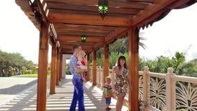 Dubai, United Arab Emirates, Uae - November 20, 2017: Hotel Jumeirah Al Qasr Madinat, family walk along a wooden gazebo. Decorated with lanterns in Arabic stock video footage